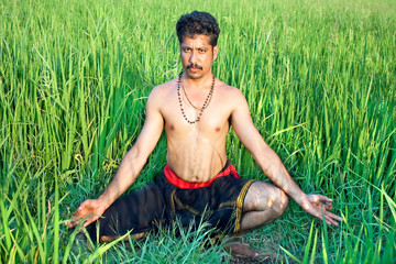 Man have a meditation in rice field