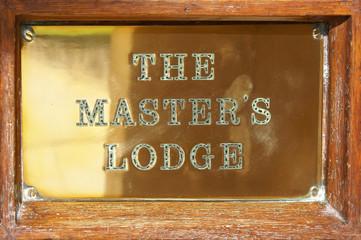 Metal plaque on the door  in Cambridge University