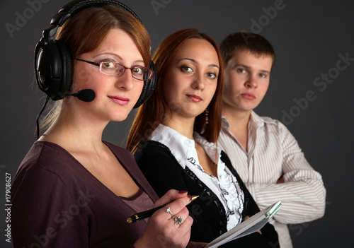 Three young happy and successful businesspeople