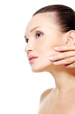 Beauty woman stroking her clean purity skin of face poster