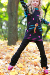jumping girl in autumn park