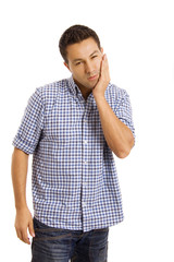 Young casual man whith a toothache over white background