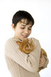A boy holding a cat