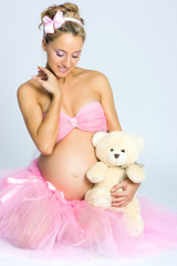 Pregnant girl with teddy bear
