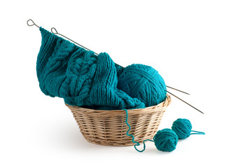 blue knitting and clews in the basket.