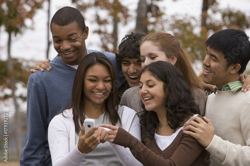 Young people looking at cell phone