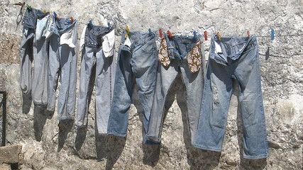 Hanging jeans trousers drying