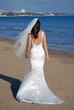 Beautiful bride walking along beach