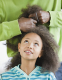 African father styling daughter's hair