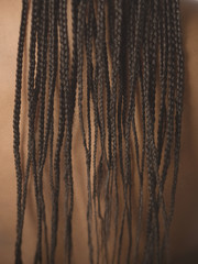 Close up of African woman's long braids