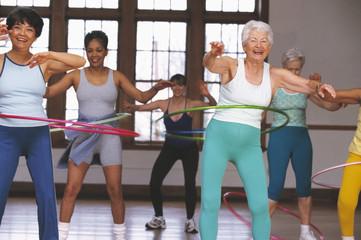Senior women in hula hoop class