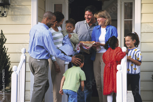 Two families greeting each other on porch