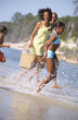 African family playing at beach