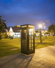 Phone box next to park at night