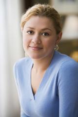 Hispanic woman smiling indoors
