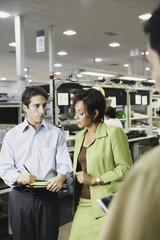 Businesspeople talking in warehouse