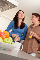 Happy couple having fun in the kitchen