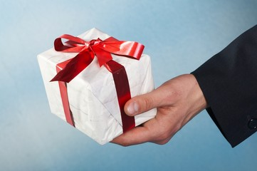 man holiday and offering a gift on his hand