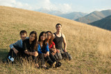 Group of young asian people sitting in the mountains