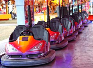 A Row of Dodgem Cars on a Fun Fair Amusement Ride.