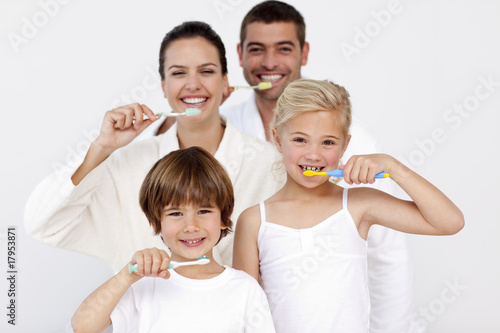 Family cleaning their teeth in bathroom