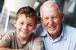 Portrait of a happy senior man with grandson