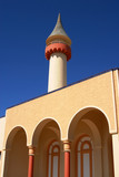 Tower and arcades detail on blue sky background poster