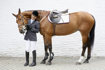 Hispanic female equestrian and horse
