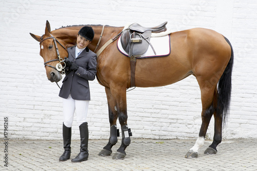 Hispanic female equestrian and horse