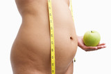 Overweight woman body holding apple with measuring tape poster