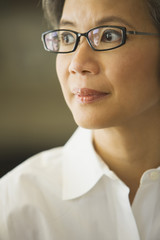 Close up of middle-aged Asian woman wearing eyeglasses