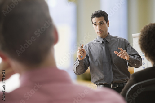 Hispanic businessman giving presentation