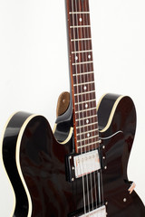 part of electric sem-hollow body guitar