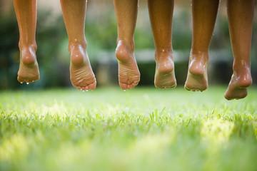 Row of Hispanic girls' wet bare feet