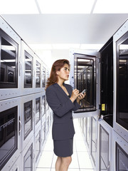 Hispanic woman in computer clean room