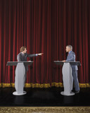 Politicians having debate on stage