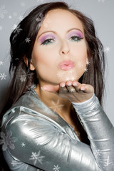 Woman blowing a kiss.