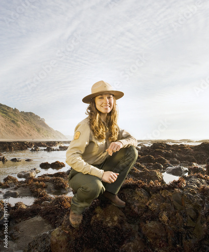 Mixed Race female park ranger next to tide pools