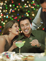 Hispanic couple drinking at Christmas time