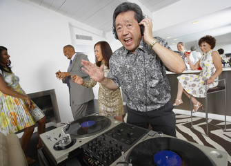Asian DJ performing at party