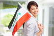 Lovely young woman with an Iraqi flag