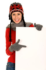 Winter girl holding blank sign