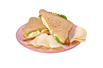 egg salad with potato chips isolated on a plate