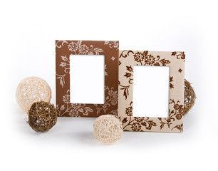 stylish wooden photo frames with two clews laying by them