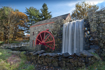 old grist mill with water wheel used to power grinding stones