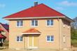 Neubau Einfamilienhaus Dachziegel Rohbau blauer Himmel
