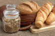 Bread, baguette and pot with grains
