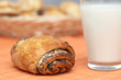 Breakfast: freshly baked bun with poppyseeds and glass with milk