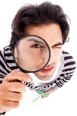 young man looking up with a magnifying glass