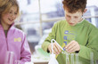 Boy and girl (8-11) in chemical lab